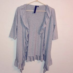 Isabella Rodriguez Gray ruffle front high/low
